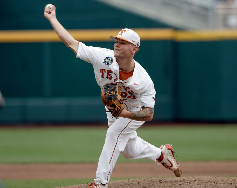 Texas pitcher and Bridge City grad Chase Shugart (24) works against Florida in the fourth inning of an NCAA College World Series baseball elimination game against Florida in Omaha, Neb., Tuesday, June 19, 2018. (AP Photo/Nati Harnik)