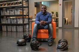 Former Washington Redskins player Shawn Springs at his Leesburg, Va., company, with helmets for which he provides pad technology.