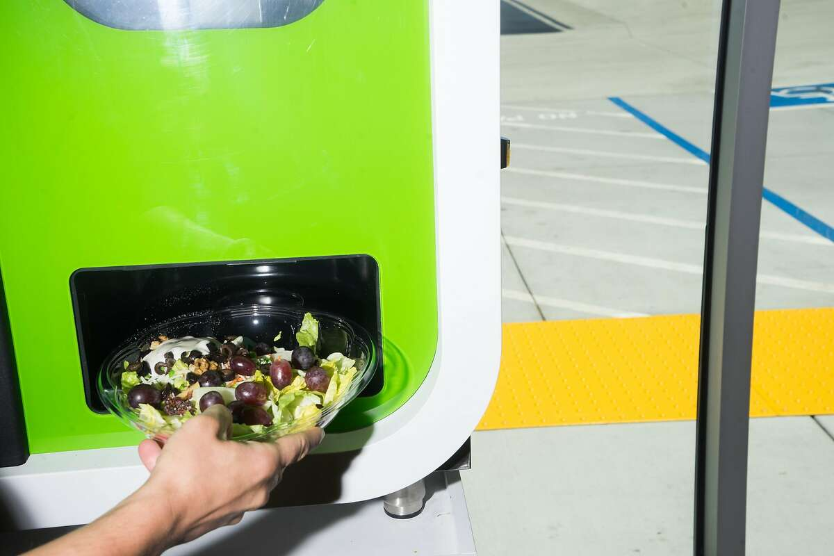 Jose Galvao of Chowbotics demonstrates how Sally, a salad-making robot, prepares salads at the Loop Neighborhood Market in Mountain View, Calif. on Thursday, June 21, 2018. Sally can make custom salads in under one minute.