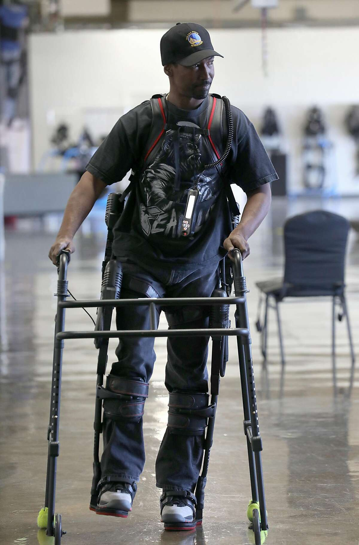Service technician Oliese Stewart test walks a product used mostly for spinal cord injuries with the help of physical therapists at Ekso Bionics on Wednesday, June 20, 2018 in Richmond, Calif.