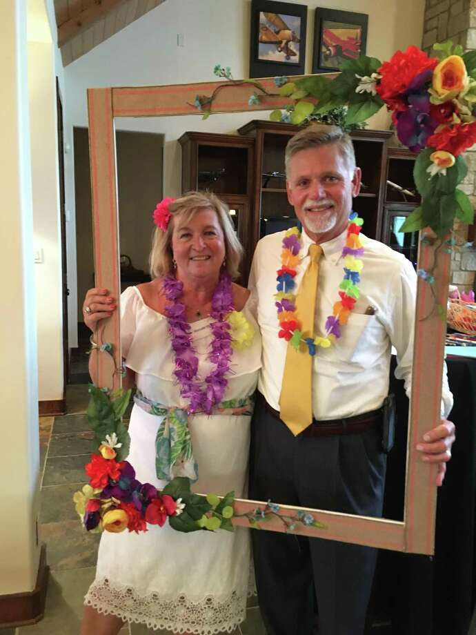 Alan and Melinda Dominy at a Conroe Service League luau held at their home on June 19. Ten new members for 2018-2019 were celebrated Photo: Courtesy Photo