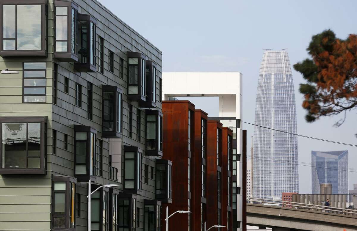 Salesforce Tower peeks out behind O + M apartments at 800 Indiana St. in the Dogpatch neighborhood of San Francisco. Some data companies that follow rental costs cover only large apartment complexes.