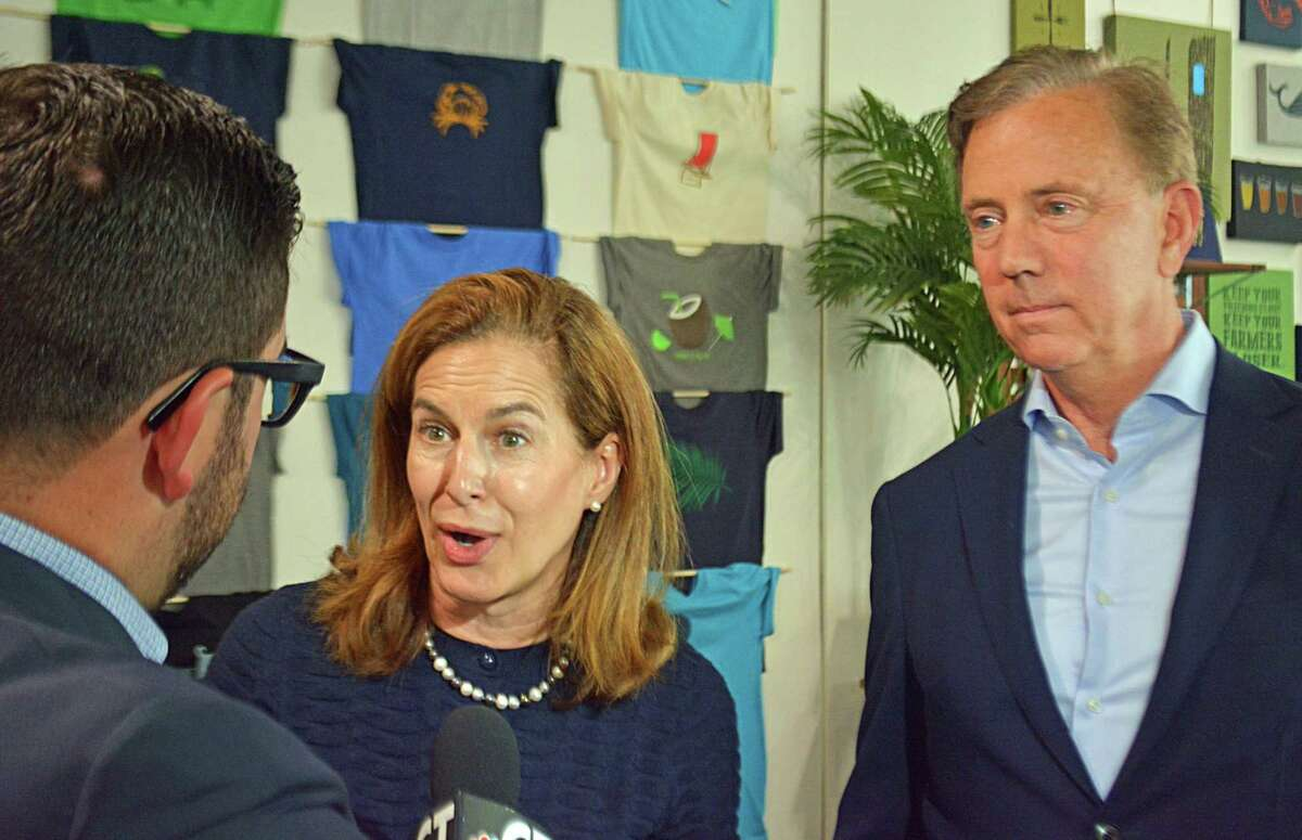 Susan Bysiewicz, center, and Ned Lamont, right, answer reporters' questions Friday in Middletown.