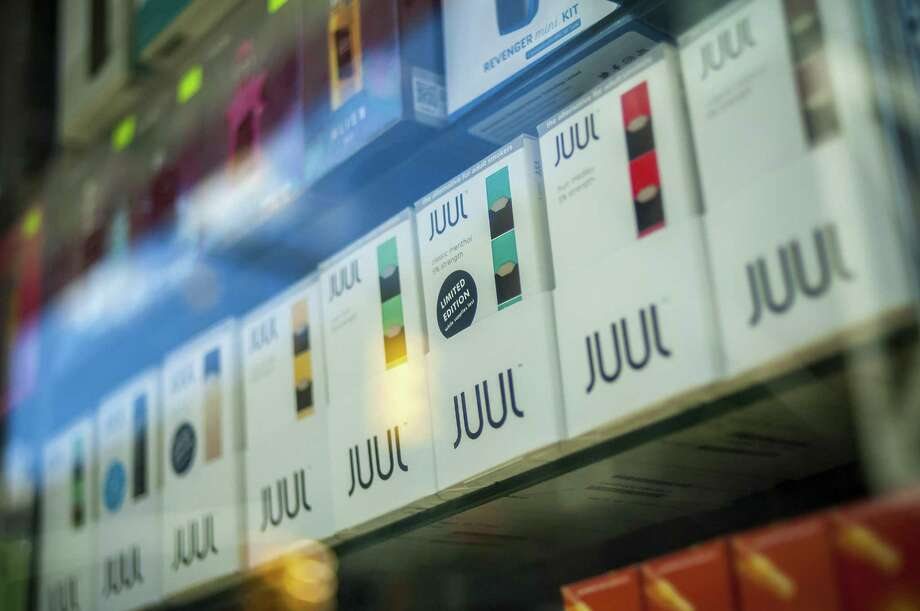 A selection of the popular Juul brand vaping supplies are on display in the window of a vaping store in New York in March. Photo: Richard B. Levine / TNS / Sipa USA