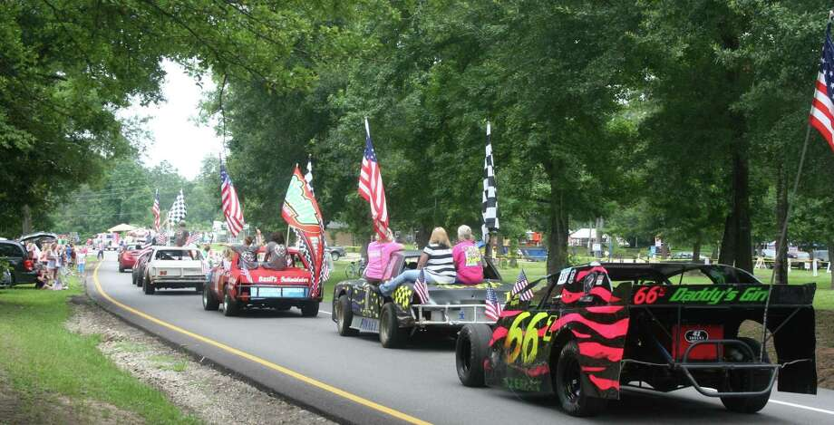 Race cars representing Bronco Raceway rode through a previous Fourth of July parade in Roman Forest. Photo: STEPHANIE BUCKNER / The Observer / The Observer