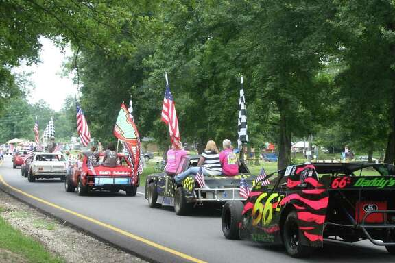 Race cars representing Bronco Raceway rode through a previous Fourth of July parade in Roman Forest.