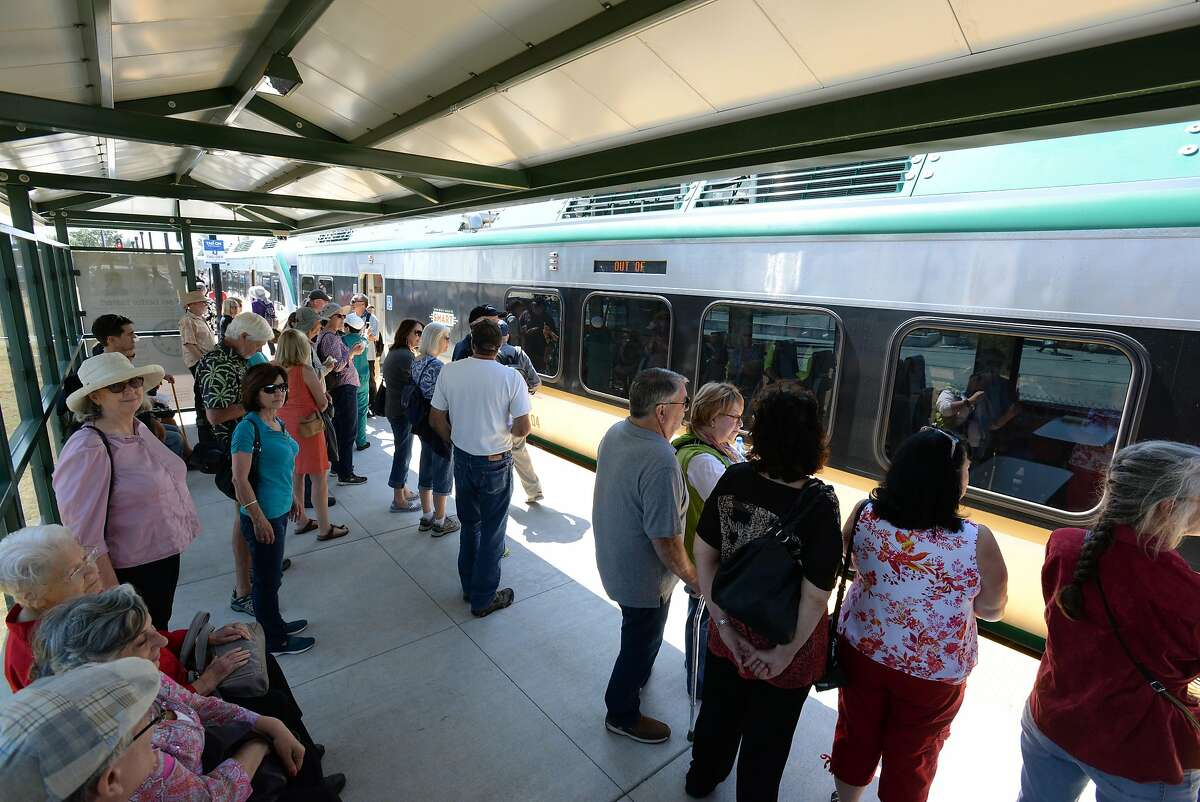 Passengers gather as the train arrives on the first day of SMART train service departing from the Sonoma County Airport station Friday at 12:49 p.m. in Santa Rosa, California. Rides are free today. August 25, 2017.