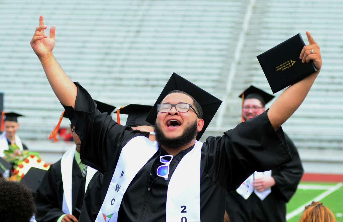 Information Technology graduate Jose Juarez, of Bridgeport, celebrates after getting his diploma during the Interdistrict Science Magnet School's 3rd Annual Commencement Ceremony at Central High School's Kennedy Stadium in Bridgeport, Conn., on Friday June 22, 2018.