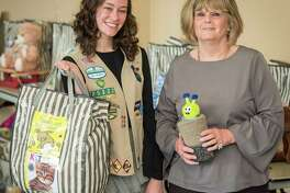 Girl Scout and West University teen Katie Crabb and Harris County Department of Education occupational therapy assistant Mary Canada are helping local youths enjoy the written word.