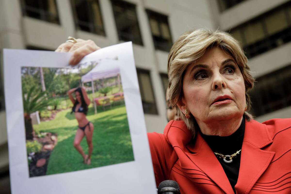 Attorney Gloria Allred holds up a photo of former Houston Texans cheerleader Angelina Rose during a press conference to discuss a lawsuit against the Houston Texans football franchise, outside the headquarters of the National Football League (NFL) in Midtown Manhattan, June 22, 2018 in New York City. The lawsuit alleges that former Houston Texans cheerleader Angelina Rose was body shamed by superiors and forced to duct tape parts of her body during games to make her body appear tighter.