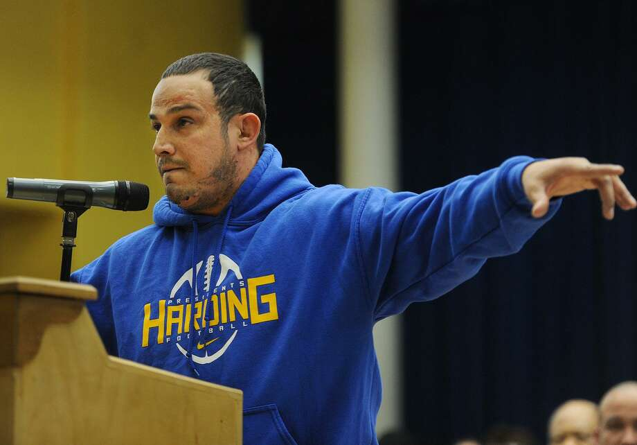 Harding High School football and wrestling coach Eddie Santiago points to his players as he addresses a public hearing over budget cuts before the Bridgeport Board of Education at Geraldine Johnson School in Bridgeport, Conn. on Monday, April 30, 2018. Photo: Brian A. Pounds / Hearst Connecticut Media / Connecticut Post
