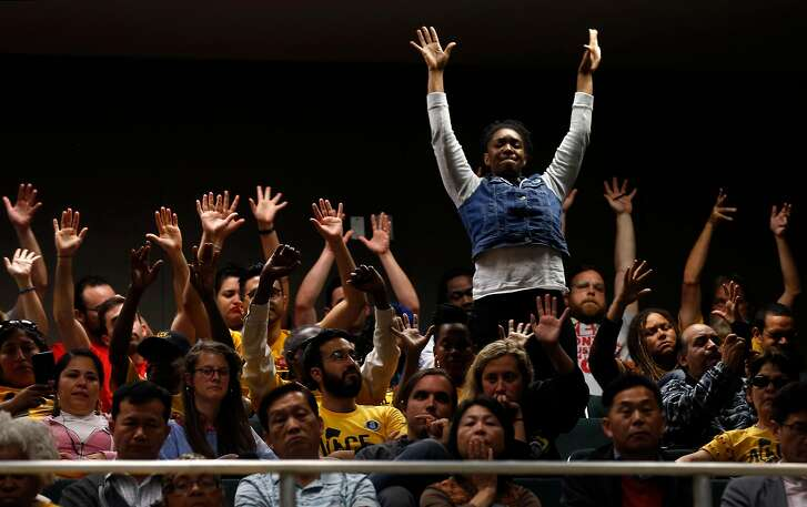 Supporters of tenants rights wave their hands in the air during a joint hearing on the statewide ballot measure to repeal the Costa-Hawkins rental housing act at the State Capitol in Sacramento, Calif. on Thursday, June 21, 2018.