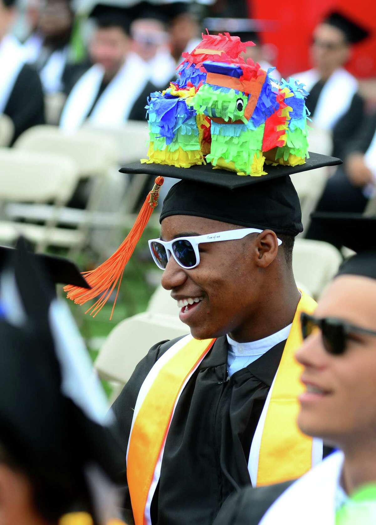 Pinatas decorate the cap of graduate Isiaiah Smith, of Bridgeport, during the Interdistrict Science Magnet School's 3rd Annual Commencement Ceremony at Central High School's Kennedy Stadium in Bridgeport, Conn., on Friday June 22, 2018.