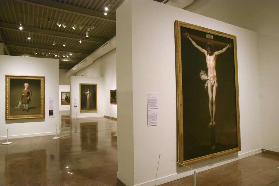 """Spain: 500 Years of Spanish Painting from the Museums of Madrid,"" a new Tricentennial exhibit at the San Antonio Museum of Art, includes 24 pieces that have never been exhibited in the United States. That includes ""The Crucifixion"" by Alonso Cano, which was painted in about 1646. Photo: Billy Calzada /San Antonio Express-News / San Antonio Express-News"