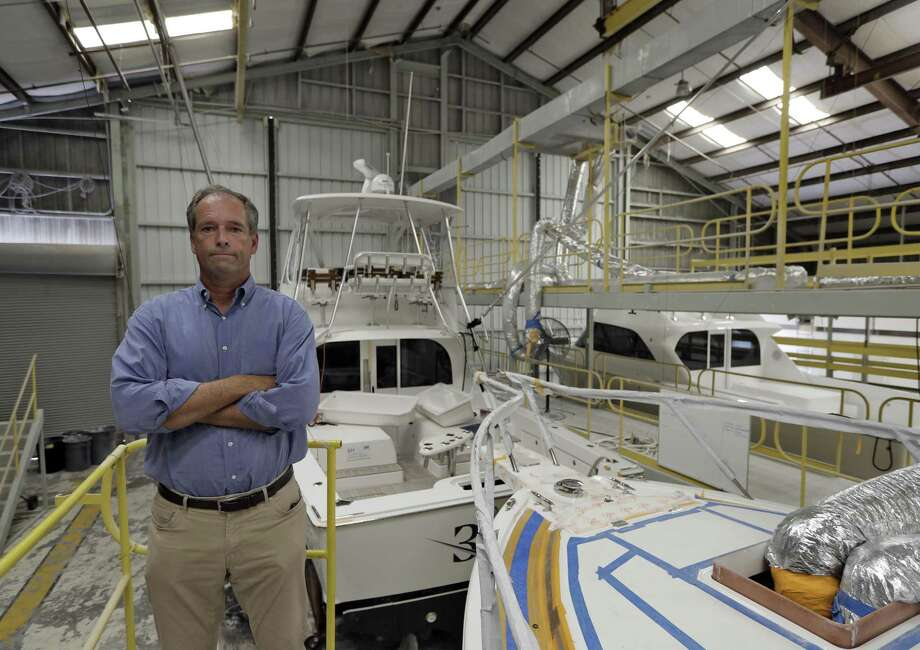 Peter Truslow, Chief Executive Officer for Bertram, a boat building company, poses near three of his custom made boats Friday, June 22, 2018, in Tampa, Fla. Photo: Chris O'Meara /Associated Press / Copyright 2018 The Associated Press. All rights reserved.