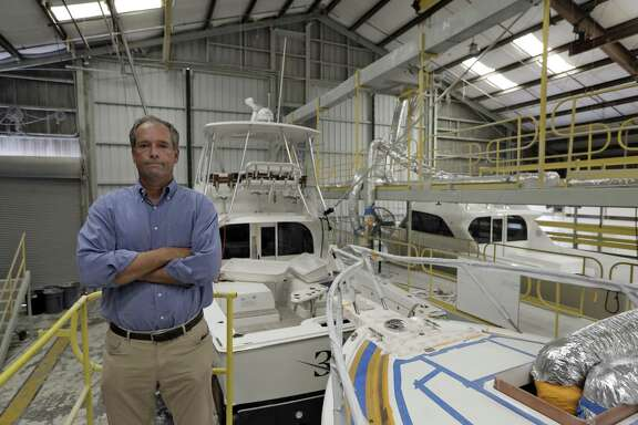 Peter Truslow, Chief Executive Officer for Bertram, a boat building company, poses near three of his custom made boats Friday, June 22, 2018, in Tampa, Fla.
