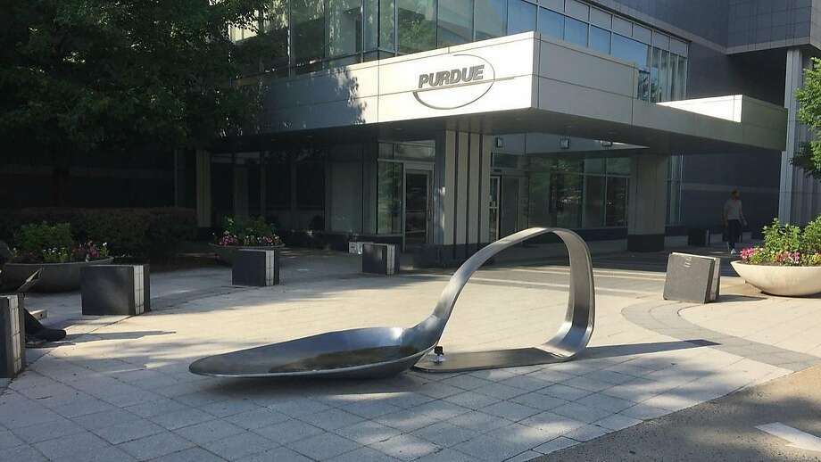 "An 800-pound sculpture, titled ""Purdue,"" created by artist Domenic Esposito is displayed outside the Connecticut headquarters of drugmaker Purdue Pharma, Friday, June 22, 2018, in Stamford, Conn. The sculpture was inspired to create by Esposito's brother's battle with addiction. Several state and local governments are suing Purdue Pharma for allegedly using deceptive marketing to boost sales of its opioid painkiller OxyContin, blamed for opioid overdose deaths. (Susan Dunne/Hartford Courant via AP) Photo: Susan Dunne / Associated Press"