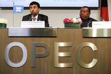 Suhail Mohammed Al Mazrouei, United Arab Emirates' energy minister and president of the Organization of Petroleum Exporting Countries (OPEC), left, speaks as Mohammed Barkindo, secretary general of the Organization of Petroleum Exporting Countries (OPEC), listens during a news conference following the 174th Organization Of Petroleum Exporting Countries (OPEC) meeting in Vienna, Austria, on Friday, June 22, 2018. OPEC has agreed to boost oil production, achieving a last-minute compromise that overcame Iran's threats to veto any supply hike. Photographer: Stefan Wermuth/Bloomberg
