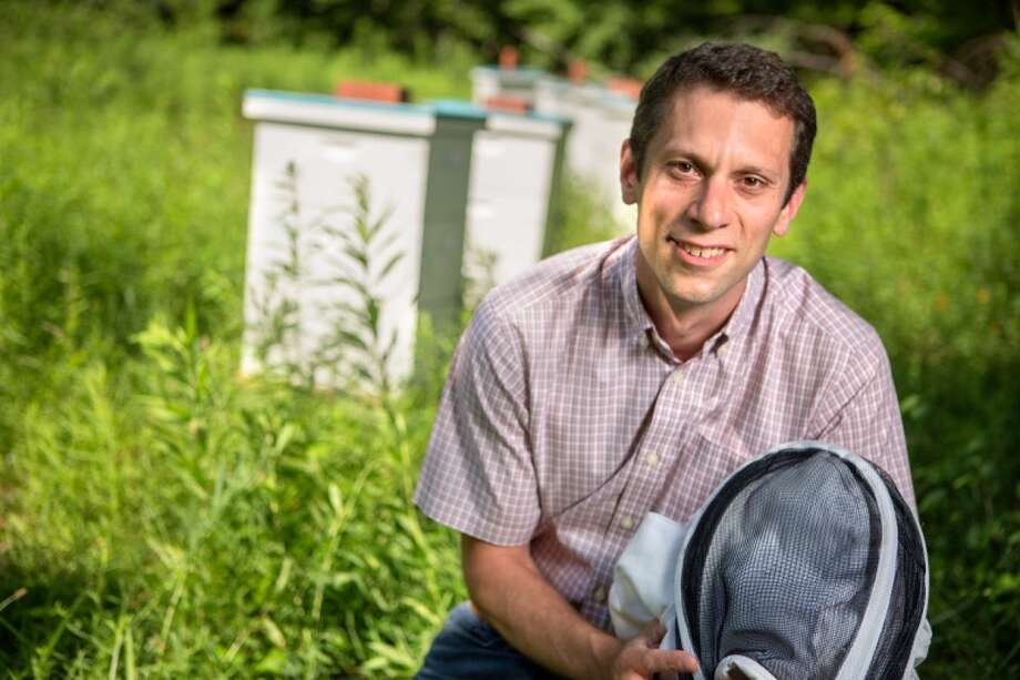 Scott McArt, an assistant entomology professor at Cornell University, has researched a link between pesticides and fungicides that can be extremely toxic to honeybees. Photo: Courtesy Of Cornell University