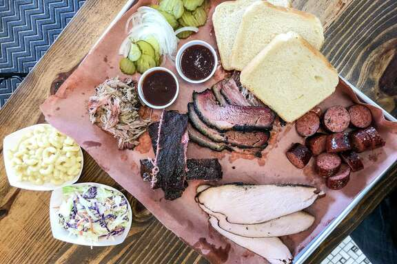 Barbecue tray with brisket, sausage, pulled pork, turkey and pork ribs at Henderson & Kane General Store