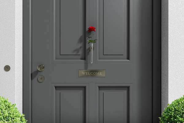 metaphorical welcome image showing a classical door with welcome sign and a red rose - rendering
