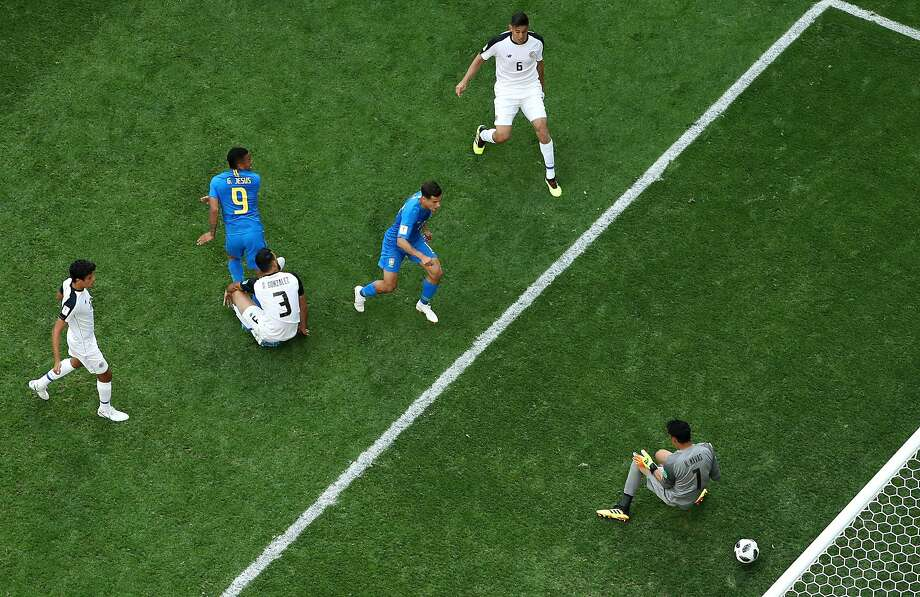 Philippe Coutinho (third from left) scores Brazil's first goal — in extra time — the opening goal past Costa Rica goaltender Keylor Navas in St. Petersburg, Russia. Photo: Richard Heathcote / Getty Images