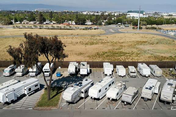 Recreational vehicles line a parking lot at VTA's Cerone bus yard in San Jose, Calif., on Monday, June 18, 2018. The transit agency permits some employees, who have long commutes, to sleep overnight in the lot.