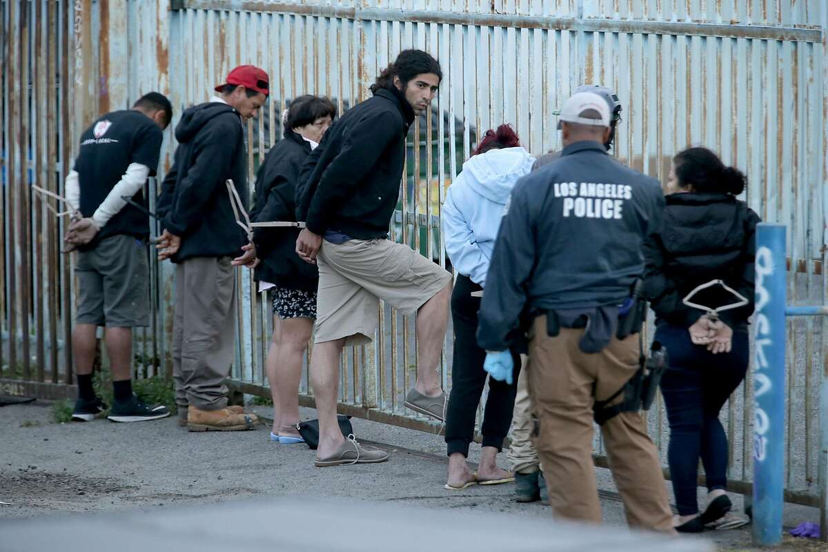 Authorities arrested 21 suspected members of the violent gang MS-13 in Los Angeles County early Wednesday morning, May 17, 2017. (Irfan Khan/Los Angeles Times/TNS)