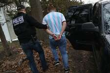 BRENTWOOD, NY - MARCH 29:  Homeland Security Investigations (HSI) ICE agents detain a suspected MS-13 gang member and Honduran immigrant at his home on March 29, 2018 in Brentwood, New York. Overnight and into the morning, U.S. federal agents and local police detained suspected gang members across Long Island in a surge of arrests. The actions were part of Operation Matador, a nearly year-long anti-gang effort targeting transnational gangs, with an emphasis on MS-13.  (Photo by John Moore/Getty Images)