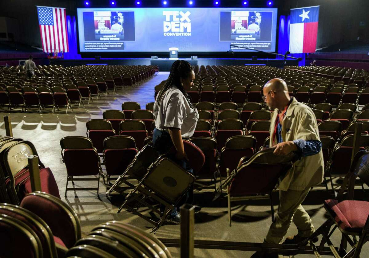 Workers set up chairs in the main arena in preparation for the Texas Democratic Convention on Thursday, June 21, 2018 at the Fort Worth Convention Center in Fort Worth. (Ashley Landis/The Dallas Morning News) ***Note - I was allowed to take photos of the workers, but they were not allowed to give their names.