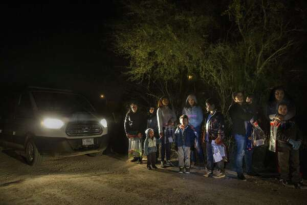 After crossing the Rio Grande River at night with the help of smugglers, a group of mainly women and children from Central America are detained by U.S. Border Patrol agents before being taken into detention on Jan. 27, 2017. These days, such families are being separated by U.S. immigration authorities.