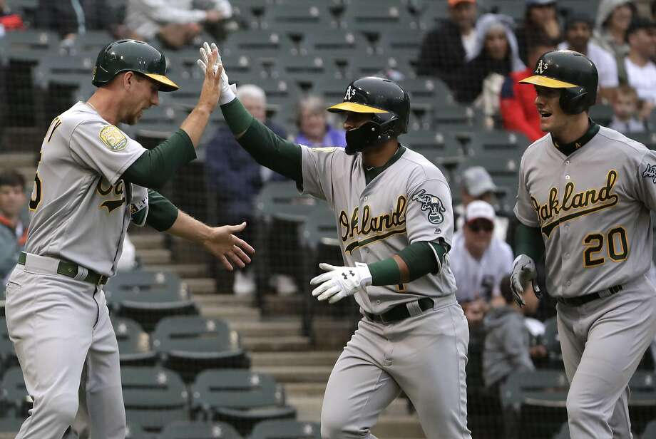 Oakland Athletics' Franklin Barreto, center, celebrates with Stephen Piscotty, left, and Mark Canha after hitting a three-run home run against the Chicago White Sox during the second inning of the first game of a baseball doubleheader in Chicago, Friday, June 22, 2018. (AP Photo/Nam Y. Huh) Photo: Nam Y. Huh / Associated Press