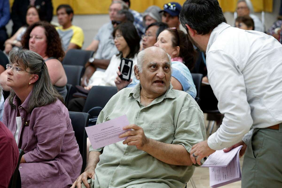 Behram Leskari of Pittsburg asks for a public comment slip during a community forum hosted by the Contra Costa Environmental Health and County Supervisor Federal Glover at Ambrose Community Center in Bay Point, Calif., on Thursday, June 21, 2018. The forum was held to answer questions about the alleged disposal of potentially radioactive materials from the Hunters Point Naval Shipyard at Keller Canyon Landfill in Bay Point.