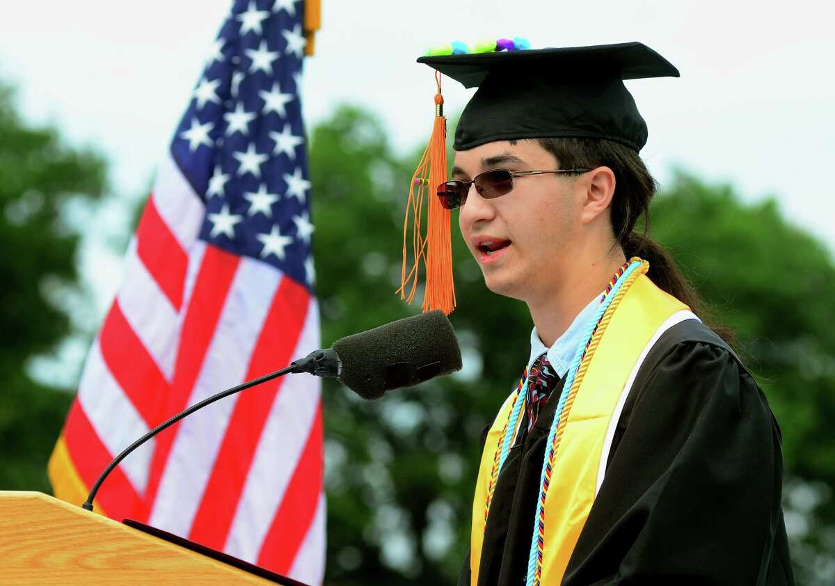 Information Technology & Software Engineering Valedictorian Kenneth Wright speaks to the Class of 2018 during the Interdistrict Science Magnet School's 3rd Annual Commencement Ceremony at Central High School's Kennedy Stadium in Bridgeport, Conn., on Friday June 22, 2018.