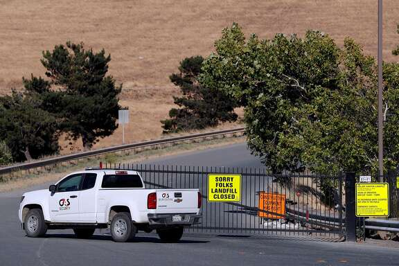 A security vehicle cruises by the closed gates at Keller Canyon Landfill before a community forum hosted by the Contra Costa Environmental Health and County Supervisor Federal Glover at Ambrose Community Center in Bay Point, Calif., on Thursday, June 21, 2018. The forum was held to answer questions about the alleged disposal of potentially radioactive materials from the Hunters Point Naval Shipyard at Keller Canyon Landfill in Bay Point.