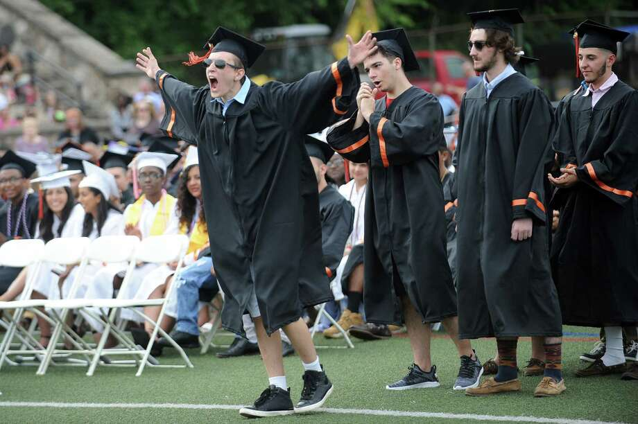 Ilir Hulaj screams as he walks to the stage to receive his diploma during the Stamford High School class of 2018 commencement ceremony in Stamford High School's Boyle Stadium on Friday, June 22, 2018. Photo: Michael Cummo, Hearst Connecticut Media / Stamford Advocate