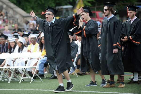 Ilir Hulaj screams as he walks to the stage to receive his diploma during the Stamford High School class of 2018 commencement ceremony in Stamford High School's Boyle Stadium on Friday, June 22, 2018.
