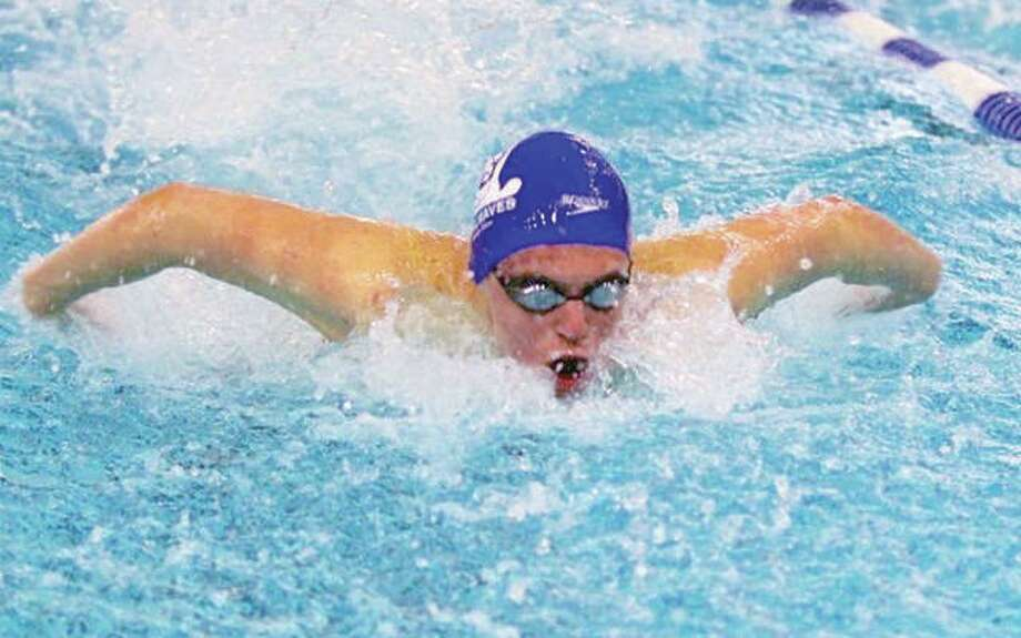 Matt Daniel of the Summers Port Sharks was a triple winner in Thursday's SWISA season-opening victory at Sunset Hills. Daniel won the 15-18 boys 50-yard butterfly, 50 freestyle and 100 individual medley. Photo:       James B. Ritter File | For The Telegraph