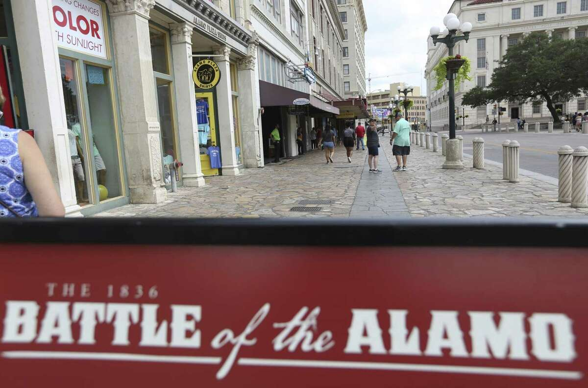 A sign explaining a part of the history of the battle of the Alamo sits June 21 on the Alamo Street sidewalk in Alamo Plaza. A design plan for the plaza is generating heat.