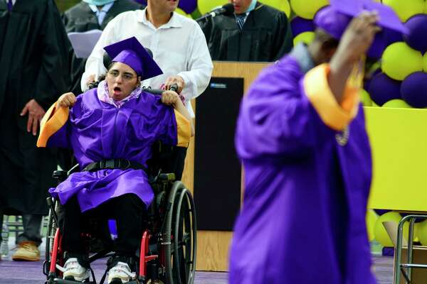 Katherine Perez celebrates after receiving her diploma during the Westhill High School Class of 2018 commencement exercises on June 22, 2018 in Stamford, Connecticut.