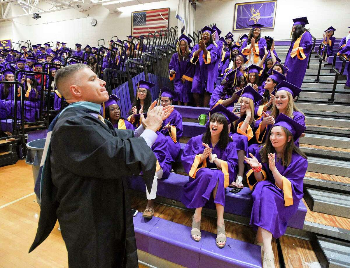 Principal Michael Rinaldi walks around to get the students psych about graduation prior to Westhill High School Class of 2018 commencement exercises on June 22, 2018 in Stamford, Connecticut.