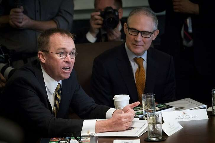 Mick Mulvaney, the Trump administration�s budget director, makes a presentation during a Cabinet meeting at the White House in Washington, June 21, 2018. Championed on by conservatives hoping to dismantle the social welfare system, the program unveiled on Thursday could have a profound effect on millions of poor and working-class Americans. At right is Scott Pruitt, the EPA chief. (Doug Mills/The New York Times)