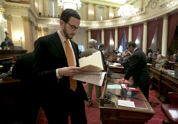 FILE - In this April 20, 2017 file photo, State Sen. Scott Wiener, D-San Francisco works at the Capitol in Sacramento, Calif. Wiener pulled his support for a net neutrality bill he sponsored after Assemblyman Miguel Santiago, D-Los Angeles, removed whole portions of the bill. It had been considered one of the nation's most aggressive efforts to revive net neutrality rules. (AP Photo/Rich Pedroncelli, File)