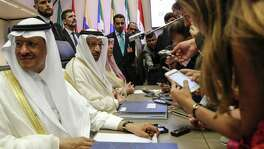 Khalid Al-Falih, Saudi Arabia's energy and industry minister, second left, speaks to reporters ahead of the 174th Organization Of Petroleum Exporting Countries (OPEC) meeting in Vienna, Austria, on Friday, June 22, 2018. OPEC and its allies reached a preliminary agreement in the face of strong opposition from Iran to boost production by a theoretical 1 million barrels a day - the actual increase will be smaller as several countries are unable to raise output. Photographer: Stefan Wermuth/Bloomberg