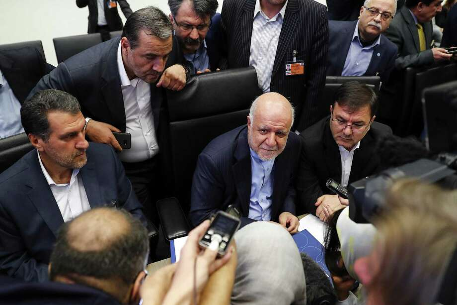 Bijan Namdar Zanganeh, Iran's petroleum minister, center, speaks to reporters ahead of the 174th Organization Of Petroleum Exporting Countries (OPEC) meeting in Vienna, Austria, in June. >>Trump's tweets on oil, Iran, China and more Photo: Stefan Wermuth / Bloomberg / © 2018 Bloomberg Finance LP