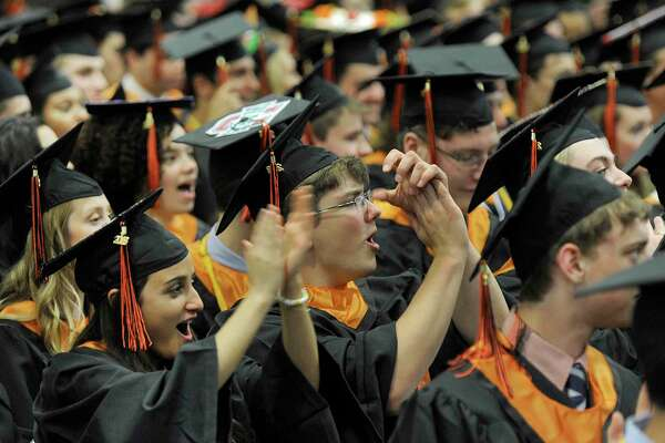 Alaina Harris and Noah Havasi applaud during Ridgefield High School's graduation ceremony held Friday, June 22, 2018, at the O'Neill Center at Western Connecticut State University.