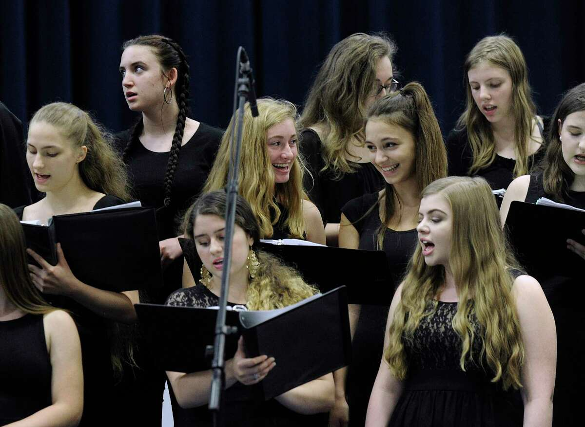 The graduation choir performs during Ridgefield High School's graduation ceremony held Friday, June 22, 2018, at the O'Neill Center at Western Connecticut State University.