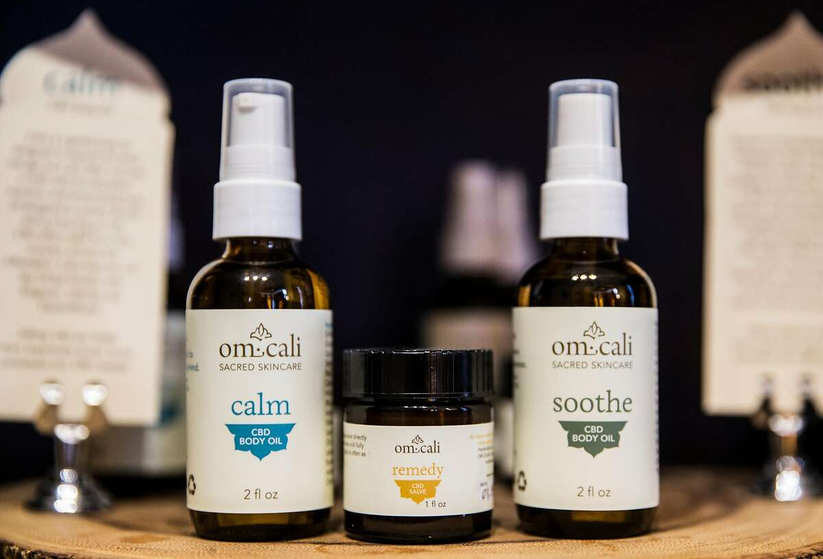 An assortment of CBD oils used in massage therapy treatments is seen on display at Earthbody spa Wednesday, April 18, 2018 in San Francisco, Calif.