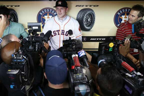 Newly signed draft pick Jayson Schroeder talks with the media during batting practice before the start of an MLB baseball game at Minute Maid Park, Friday, June 22, 2018, in Houston.  ( Karen Warren  / Houston Chronicle )
