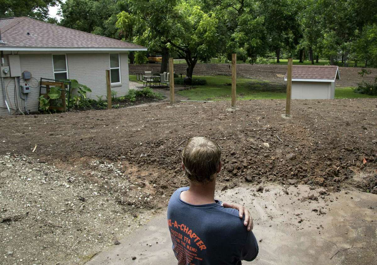 David Bush, who had a levee built around his home after it was damaged during Hurricane Harvey, looks over his property Tuesday, June 19, 2018, in Richmond. ( Jon Shapley / Houston Chronicle )